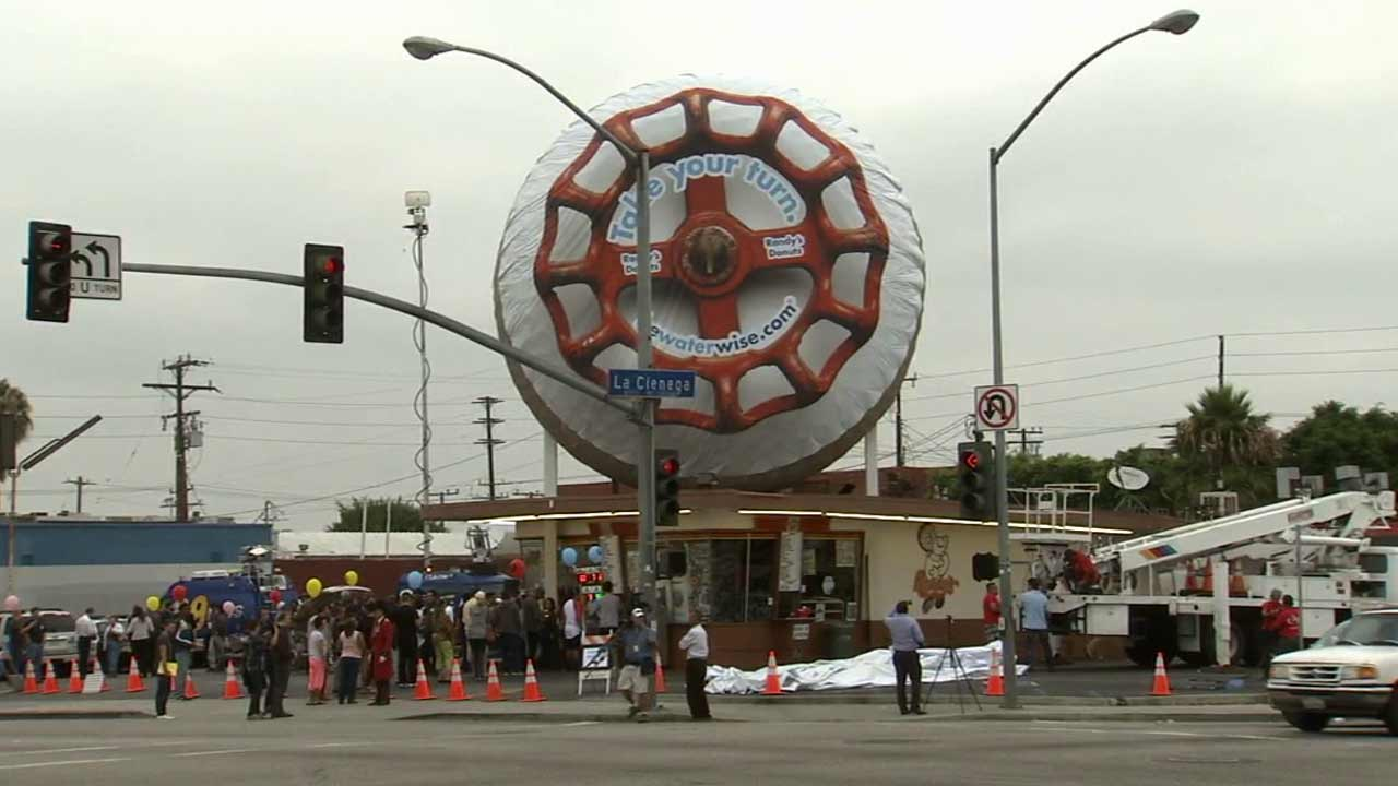 The king-sized doughnut on the roof of Randy's Donuts in the 800 block of W. Manchester Boulevard in Inglewood was transformed into a red faucet knob on Tuesday, Aug. 11, 2015.
