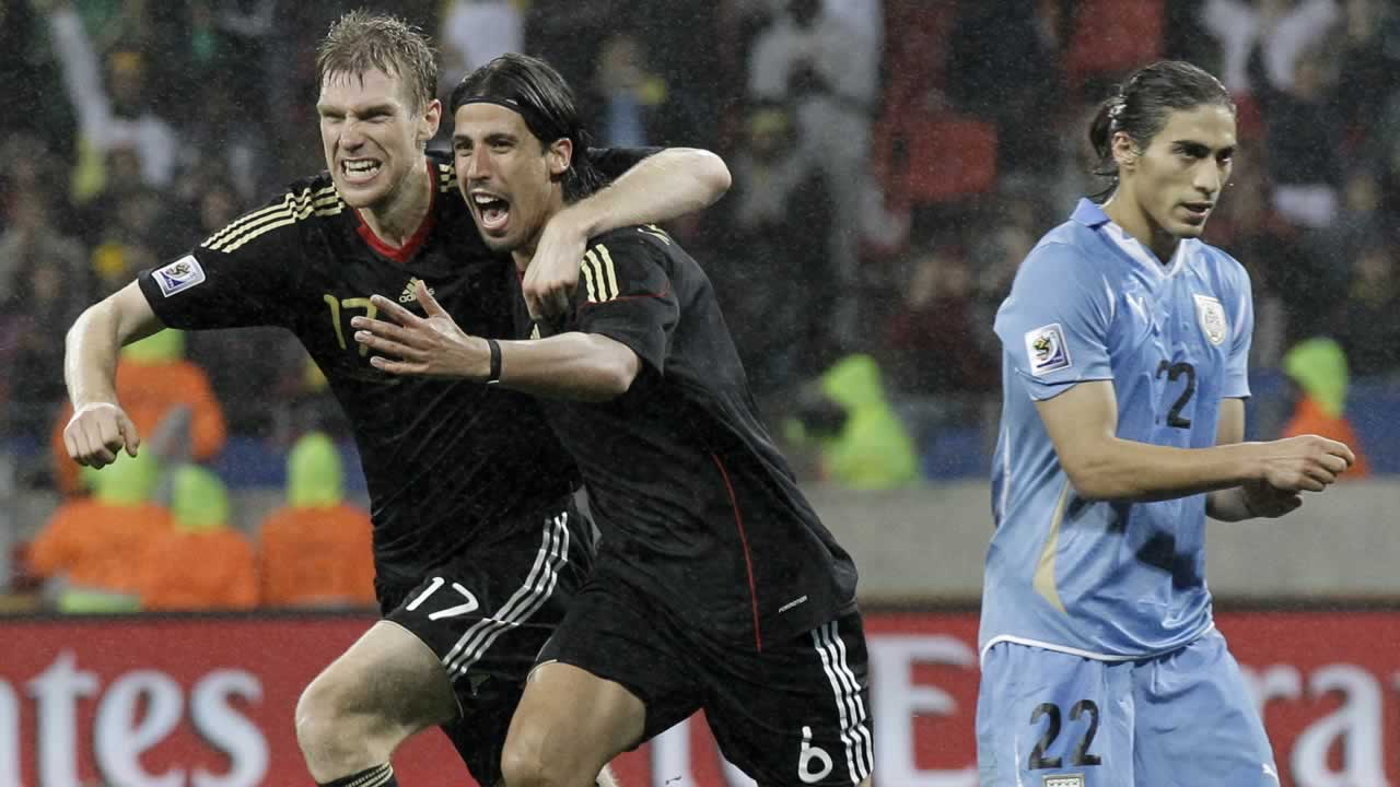 "<div class=""meta image-caption""><div class=""origin-logo origin-image ""><span></span></div><span class=""caption-text"">Germany's Sami Khedira, center, celebrates with teammate Germany's Per Mertesacker after scoring during the World Cup third-place soccer match between Germany and Uruguay. (AP Photo/Gero Breloer)</span></div>"