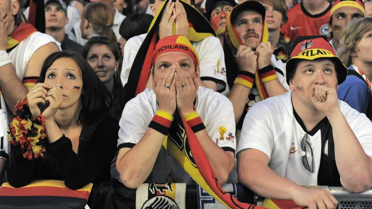 "<div class=""meta image-caption""><div class=""origin-logo origin-image ""><span></span></div><span class=""caption-text"">German fans react during watching the World Cup soccer match between Germany and Spain at a public viewing area in Berlin, Germany on  July 7, 2010. (AP Photo/Jens Meyer)</span></div>"