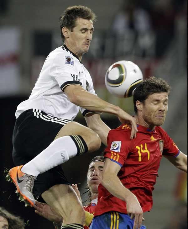 "<div class=""meta image-caption""><div class=""origin-logo origin-image ""><span></span></div><span class=""caption-text"">Germany's Miroslav Klose, left, outjumps Spain's Xabi Alonso, right, during the World Cup semifinal soccer match between Germany and Spain at the stadium in Durban, South Africa. (AP Photo/Gero Breloer)</span></div>"