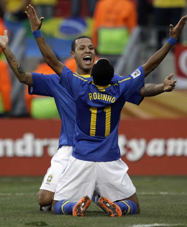 "<div class=""meta image-caption""><div class=""origin-logo origin-image ""><span></span></div><span class=""caption-text"">Brazil's Robinho celebrates with teammate Luis Fabiano after scoring his side's first goal during the World Cup quarterfinal soccer match between the Netherlands and Brazil. (AP Photo/Julie Jacobson)</span></div>"
