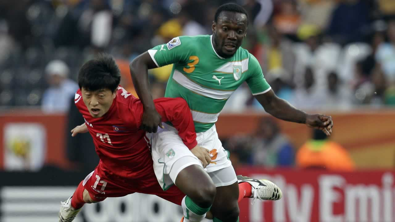 "<div class=""meta image-caption""><div class=""origin-logo origin-image ""><span></span></div><span class=""caption-text"">North Korea's Mun In Guk, left, and Ivory Coast's Arthur Boka fight for the ball during the World Cup group G soccer match between North Korea and Ivory Coast. (AP Photo/Kin Cheung)</span></div>"