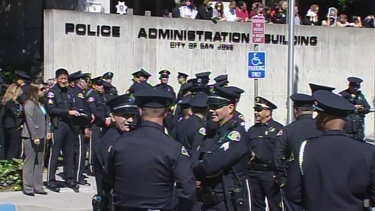 police officers stand outside San Jose police headquarters