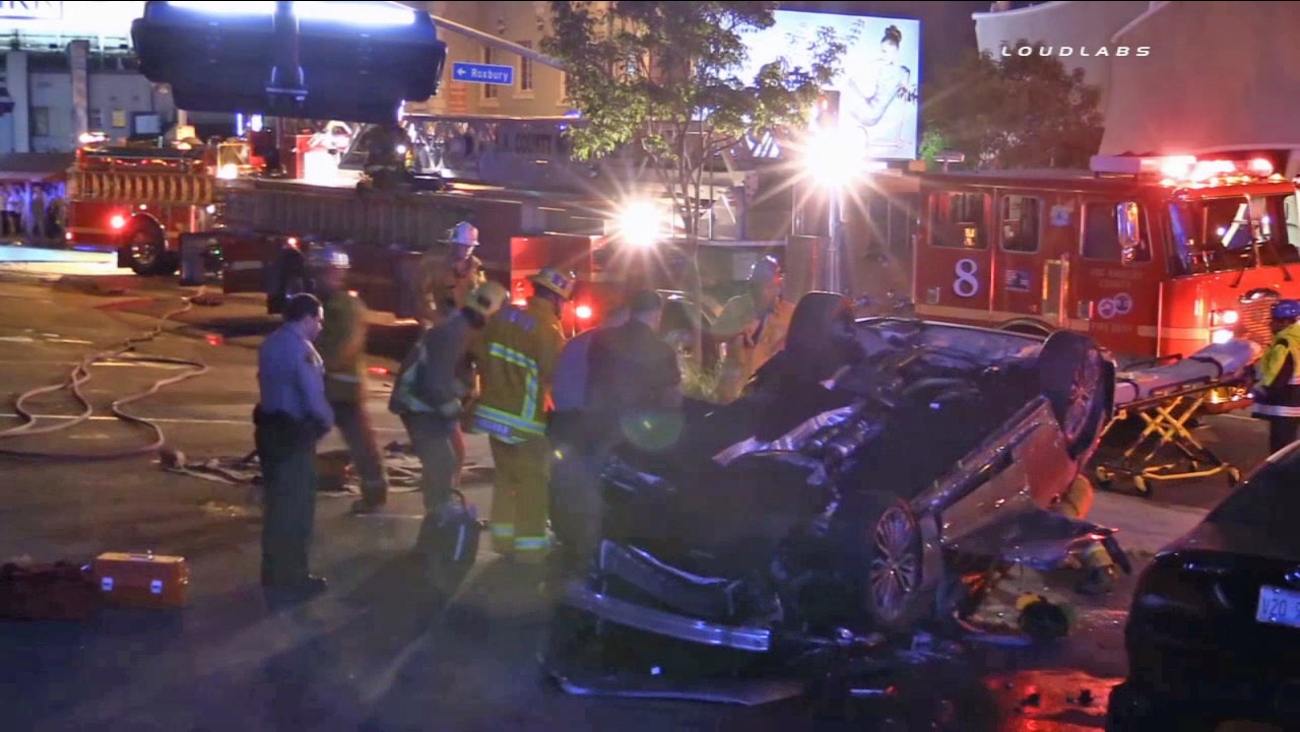 An SUV flipped onto its roof in West Hollywood in the parking lot of Pink Taco on Wednesday, Aug. 12, 2015.