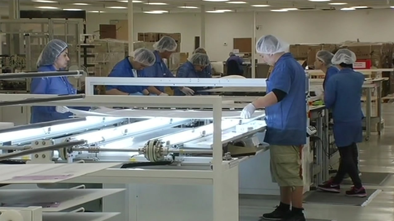 FILE: Employees at work in San Jose, Calif.