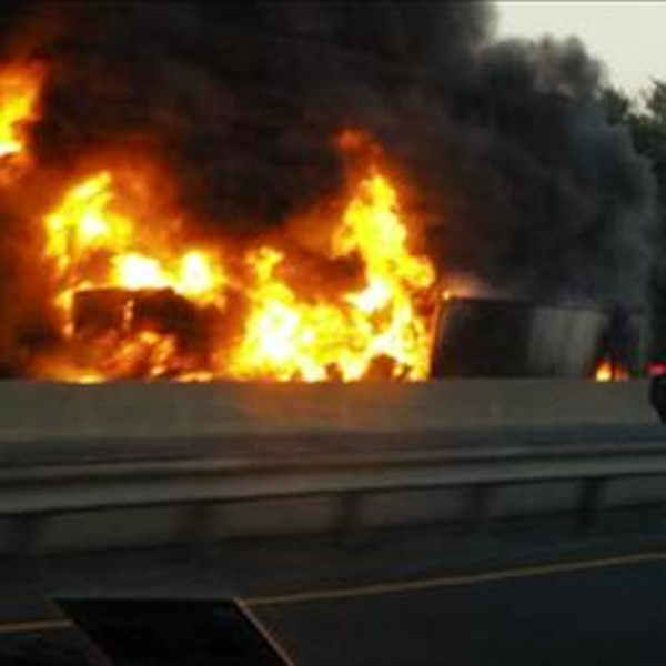 """<div class=""""meta image-caption""""><div class=""""origin-logo origin-image none""""><span>none</span></div><span class=""""caption-text"""">A fiery crash involving two tractor-trailers shut down the New Jersey Turnpike near Exit 9 in East Brunswick Wednesday night. (Photo courtesy @bkroeckel)</span></div>"""