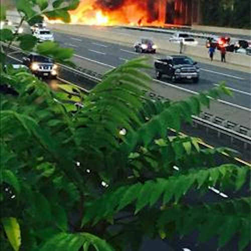 """<div class=""""meta image-caption""""><div class=""""origin-logo origin-image none""""><span>none</span></div><span class=""""caption-text"""">A fiery crash involving two tractor-trailers shut down the New Jersey Turnpike near Exit 9 in East Brunswick Wednesday night. (Photo courtesy ericrpnj via Twitter)</span></div>"""