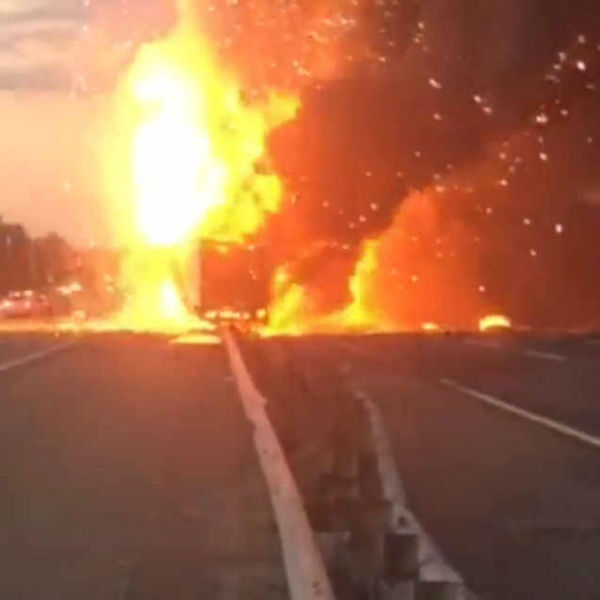 """<div class=""""meta image-caption""""><div class=""""origin-logo origin-image none""""><span>none</span></div><span class=""""caption-text"""">A fiery crash involving two tractor-trailers shut down the New Jersey Turnpike near Exit 9 in East Brunswick Wednesday night.  (Photo courtesy Joe Martucci.)</span></div>"""