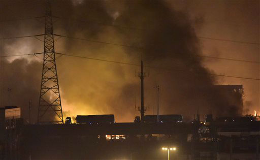 "<div class=""meta image-caption""><div class=""origin-logo origin-image none""><span>none</span></div><span class=""caption-text"">Trucks pass a bridge near the site of explosions in the Binhai New Area in northeastern China's Tianjin municipality (AP Photo/ Yue Yuewei)</span></div>"