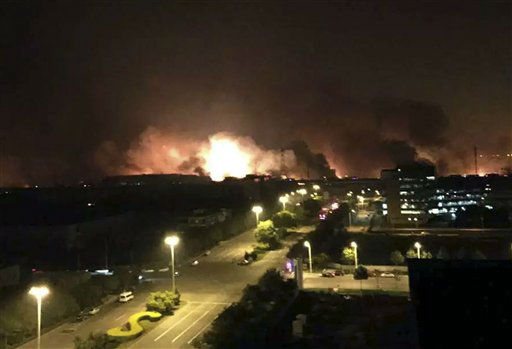 "<div class=""meta image-caption""><div class=""origin-logo origin-image none""><span>none</span></div><span class=""caption-text"">In this photo released by Xinhua News Agency smoke and fire erupt into the night sky after an explosion in the Binhai New Area (AP Photo/ Yue Yuewei)</span></div>"