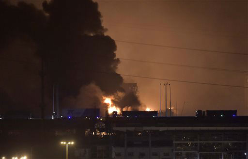 "<div class=""meta image-caption""><div class=""origin-logo origin-image none""><span>none</span></div><span class=""caption-text"">Smoke and fire erupt into the sky after an explosion in the Binhai New Area in northeastern China's Tianjin municipality (AP Photo/ Yue Yuewei)</span></div>"