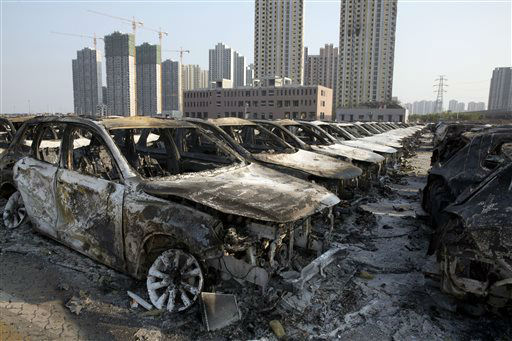 "<div class=""meta image-caption""><div class=""origin-logo origin-image none""><span>none</span></div><span class=""caption-text"">Charred remains of new cars are photographed after an explosion tore through the parking lot of a warehouse in northeastern China (AP Photo/ Ng Han Guan)</span></div>"