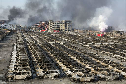"<div class=""meta image-caption""><div class=""origin-logo origin-image none""><span>none</span></div><span class=""caption-text"">Smoke billows from the site of an explosion that reduced a parking lot filled with new cars to charred remains (AP Photo/ Ng Han Guan)</span></div>"