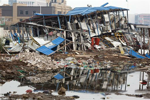 "<div class=""meta image-caption""><div class=""origin-logo origin-image none""><span>none</span></div><span class=""caption-text"">A dormitory destroyed by the shockwave of a nearby explosion is seen in the northeastern China's Tianjin municipality (AP Photo/ Ng Han Guan)</span></div>"