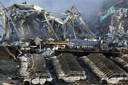 "<div class=""meta image-caption""><div class=""origin-logo origin-image none""><span>none</span></div><span class=""caption-text"">Charred remains of a warehouse and new cars are left burned after an explosion at a warehouse in northeastern China (AP Photo/ Ng Han Guan)</span></div>"