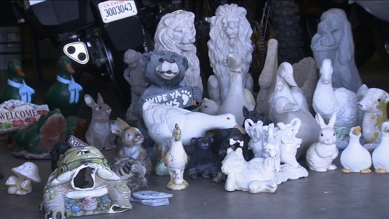 An assortment of yard ornaments found on a woman's front yard are shown in an undated image.