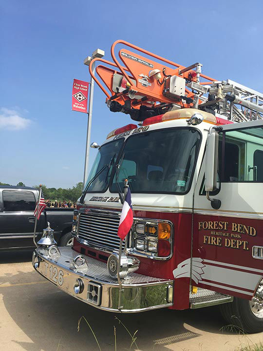 "<div class=""meta image-caption""><div class=""origin-logo origin-image none""><span>none</span></div><span class=""caption-text"">Firefighters from the Forest Bend Fire Department help the Clear Brook High School band students beat the heat.</span></div>"