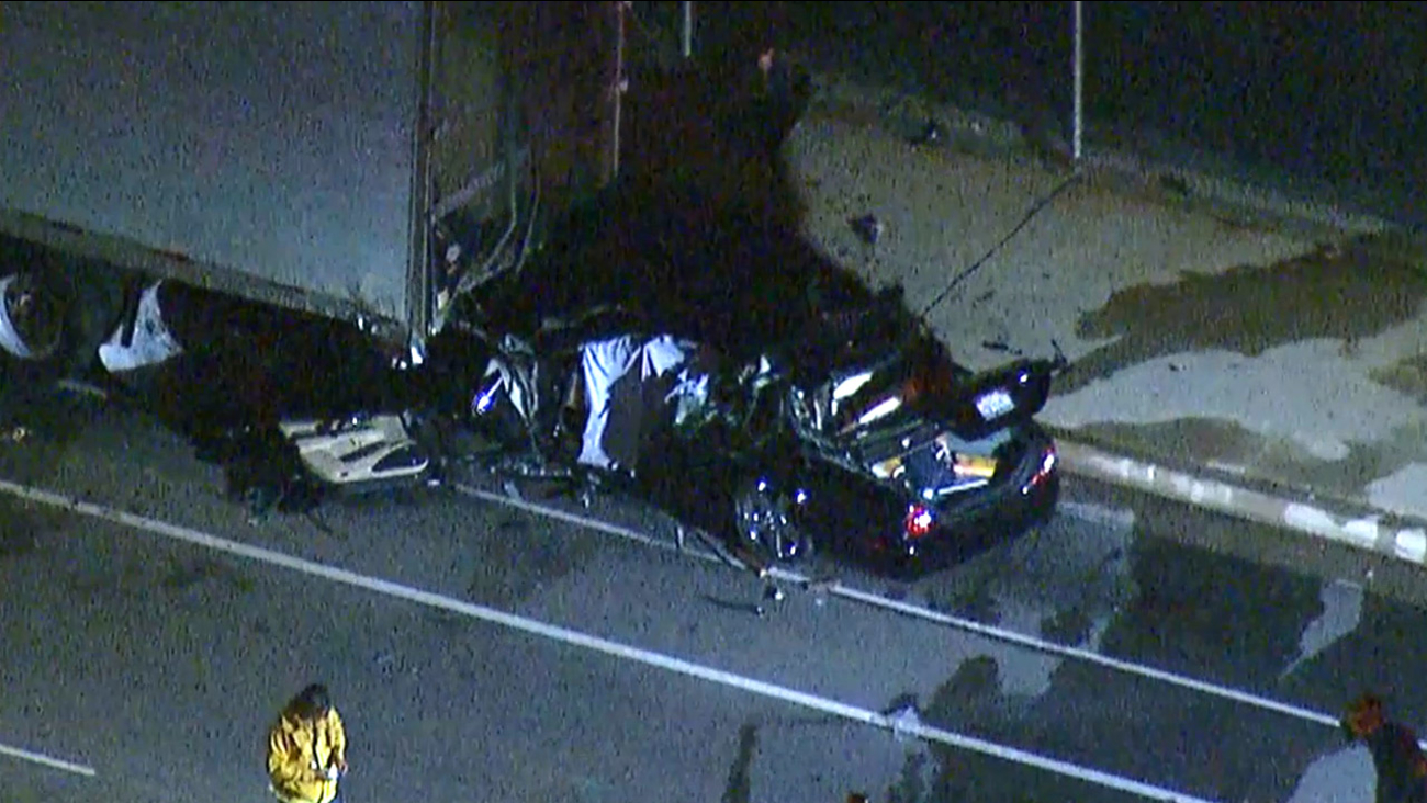 A car collided with a big rig in Granada Hills, killing one person, on Thursday, Aug. 13, 2015.