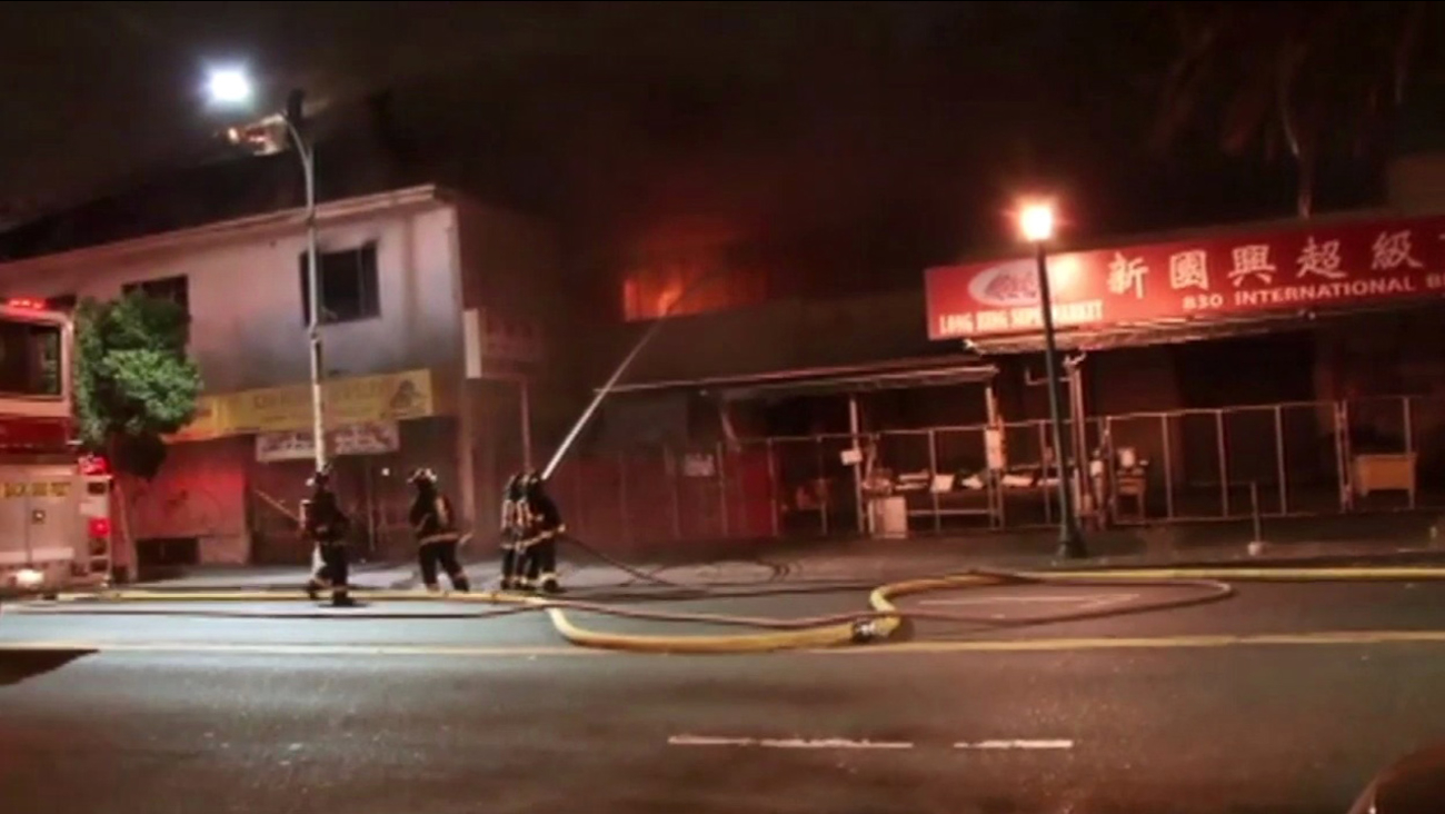 Firefighters battle three-alarm fire in Oakland, Friday, August, 14, 2015.