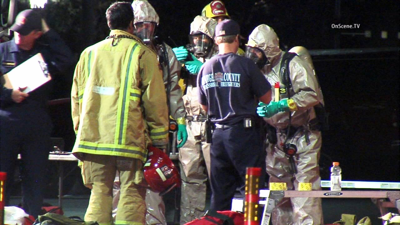 Hazmat officials are shown at University of California, Irvine on Friday, Aug. 14, 2015.