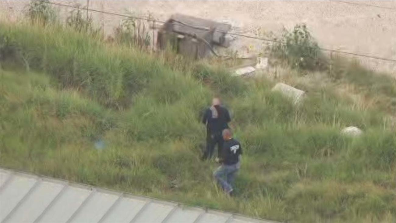 Investigators on the scene where skeletal remains were found on North Post Oak Road