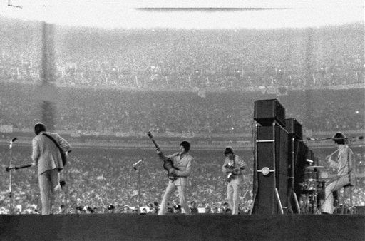 "<div class=""meta image-caption""><div class=""origin-logo origin-image none""><span>none</span></div><span class=""caption-text"">The Beatles perform at New York's Shea Stadium on August 15, 1965. (AP Photo)</span></div>"
