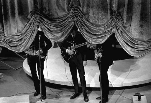 "<div class=""meta image-caption""><div class=""origin-logo origin-image none""><span>none</span></div><span class=""caption-text"">The curtain rises on the British singing group The Beatles, September 16, 1964, at a charity show in New York City. (AP Photo)</span></div>"