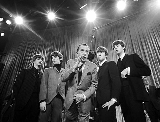 "<div class=""meta image-caption""><div class=""origin-logo origin-image none""><span>none</span></div><span class=""caption-text"">Ed Sullivan, center, stands with The Beatles during a rehearsal for the British group's first American appearance, on Feb. 8, 1964. (AP Photo/)</span></div>"