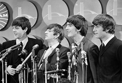 "<div class=""meta image-caption""><div class=""origin-logo origin-image none""><span>none</span></div><span class=""caption-text"">The Beatles meet reporters at Kennedy Airport in New York City, Feb. 7, 1964 on their arrival from London for their first American tour. (AP Photo)</span></div>"