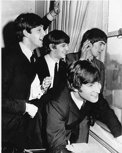 "<div class=""meta image-caption""><div class=""origin-logo origin-image none""><span>none</span></div><span class=""caption-text"">The Beatles wave to fans assembled below their Plaza Hotel window after they arrived in New York City on Feb. 7, 1964 for a short tour of the United States. (AP Photo)</span></div>"