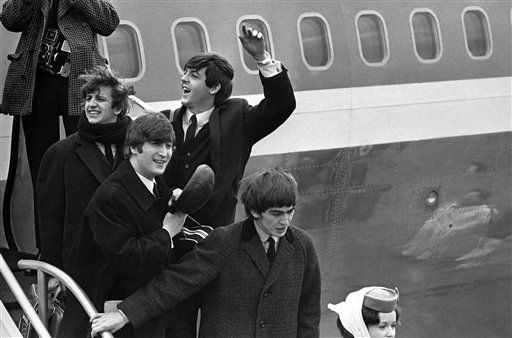 "<div class=""meta image-caption""><div class=""origin-logo origin-image none""><span>none</span></div><span class=""caption-text"">The Beatles make a windswept arrival on Feb. 7, 1964, as they step down from the plane that brought them from London, at Kennedy airport. (AP Photo)</span></div>"