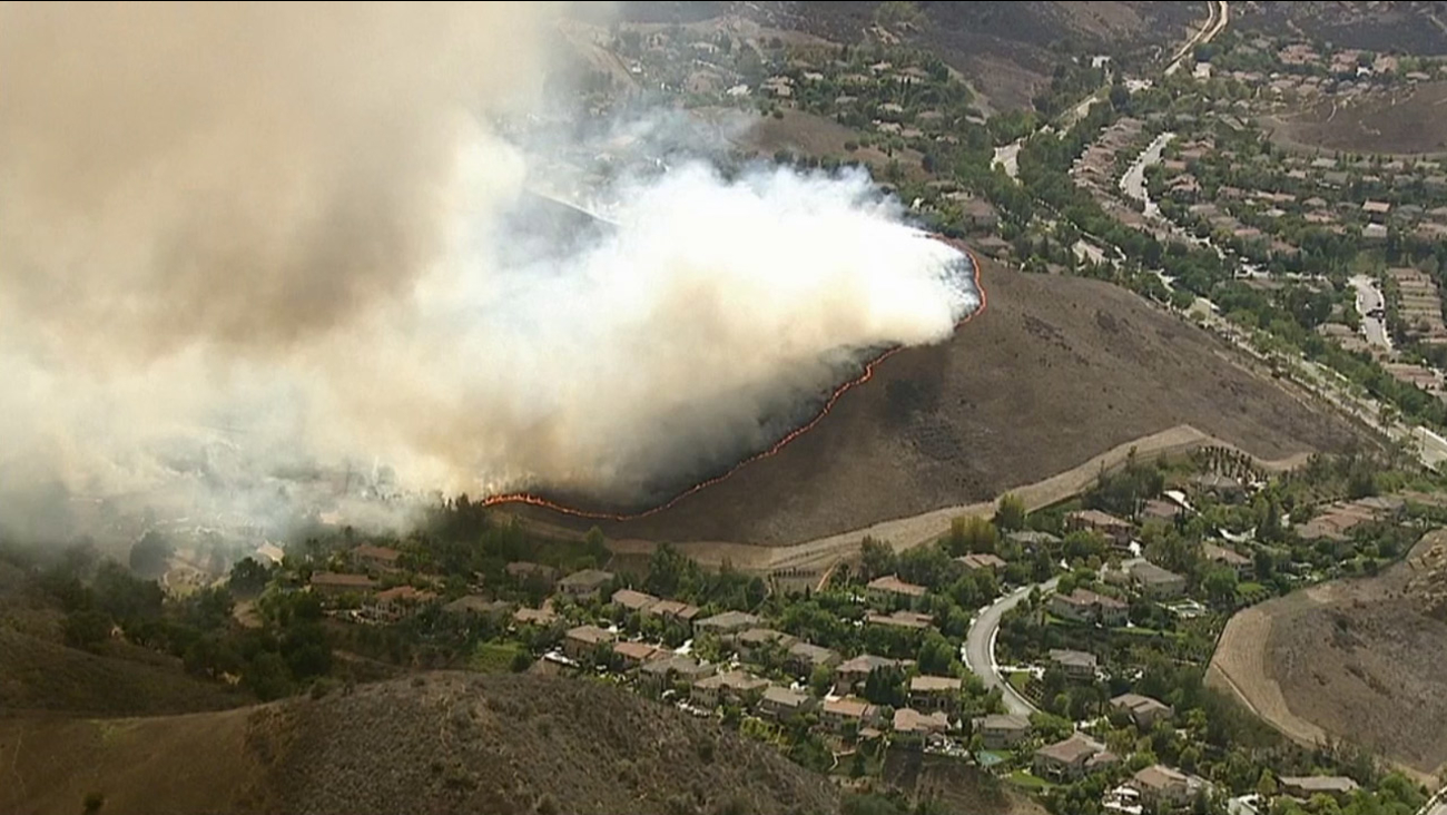 A ring of fire covers a hillside in Simi Valley on Friday, Aug. 14, 2015.