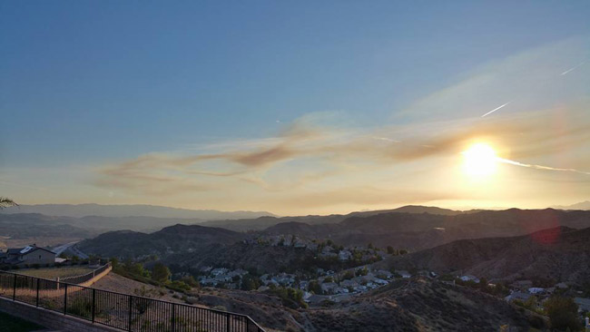 """<div class=""""meta image-caption""""><div class=""""origin-logo origin-image none""""><span>none</span></div><span class=""""caption-text"""">ABC7 viewer Andy Ryan captured visible smoke from the Rustic Fire all the way in the Santa Clarita Valley on Friday, Aug. 14, 2015. (Andy Ryan)</span></div>"""