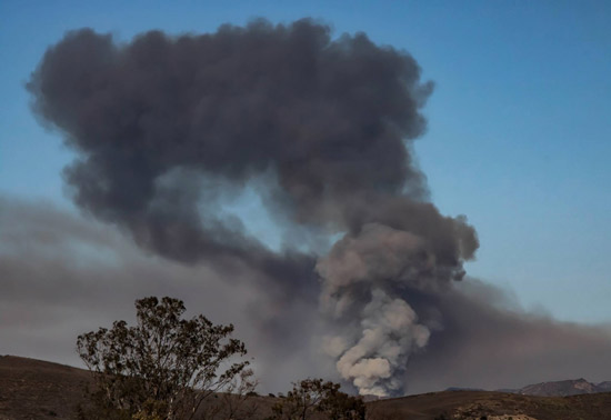 """<div class=""""meta image-caption""""><div class=""""origin-logo origin-image none""""><span>none</span></div><span class=""""caption-text"""">ABC7 viewer Tim Keagy captured an image of black smoke from the Rustic Fire out in Newbury Park on Friday, Aug. 14, 2015. (Tim Keagy)</span></div>"""