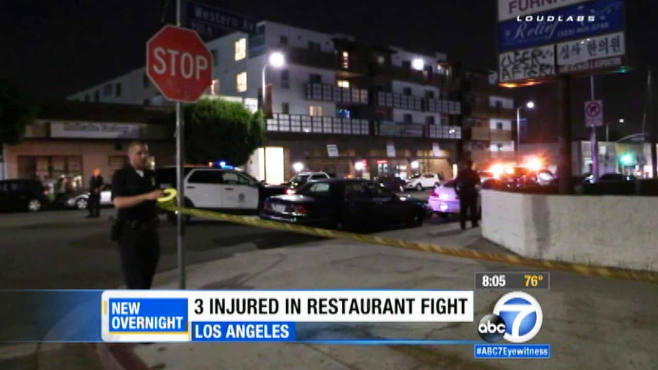 Los Angeles police responding to a shooting and stabbing at Little San Salvador Restaurant in the 900 block of N. Western Avenue in Hollywood Saturday, Aug. 15, 2015.