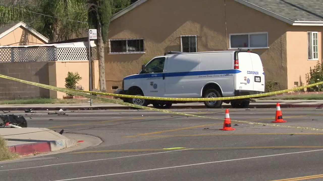 Los Angeles police investigate a fatal hit-and-run crash near the intersection of De Soto Avenue and Saticoy Street in Canoga Park on Saturday, Aug. 14, 2015.