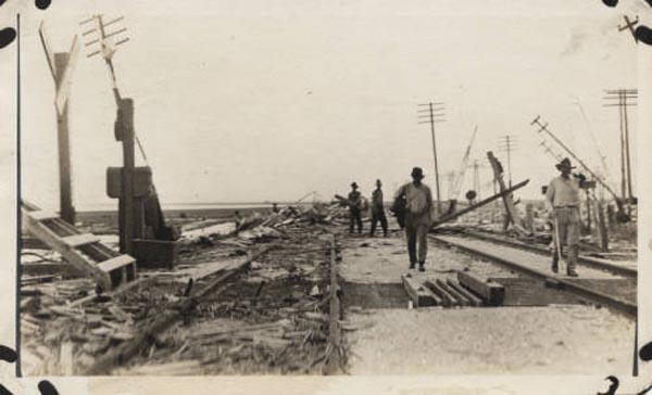 "<div class=""meta image-caption""><div class=""origin-logo origin-image none""><span>none</span></div><span class=""caption-text"">Causeway wreckage on the Santa Fe right-of-way at Virginia Point. (Special Collections, University of Houston Libraries)</span></div>"