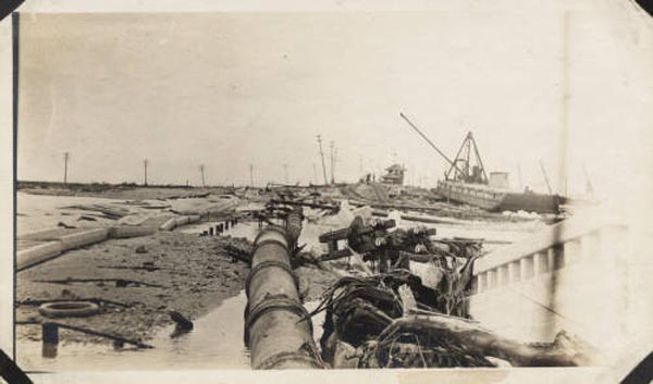 "<div class=""meta image-caption""><div class=""origin-logo origin-image none""><span>none</span></div><span class=""caption-text"">View of causeway wreckage after the hurricane at an unknown location. (Special Collections, University of Houston Libraries)</span></div>"