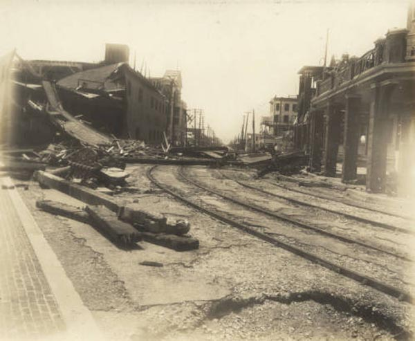"<div class=""meta image-caption""><div class=""origin-logo origin-image none""><span>none</span></div><span class=""caption-text"">View down Q street with the damage to the buildings from the hurricane. (Special Collections, University of Houston Libraries)</span></div>"