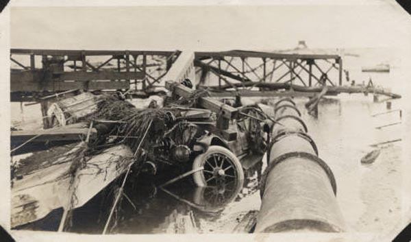 "<div class=""meta image-caption""><div class=""origin-logo origin-image none""><span>none</span></div><span class=""caption-text"">Wrecked semaphore bridge, pipe, poles, and car caught on the causeway during its hurricane caused collapse. (Special Collections, University of Houston Libraries)</span></div>"