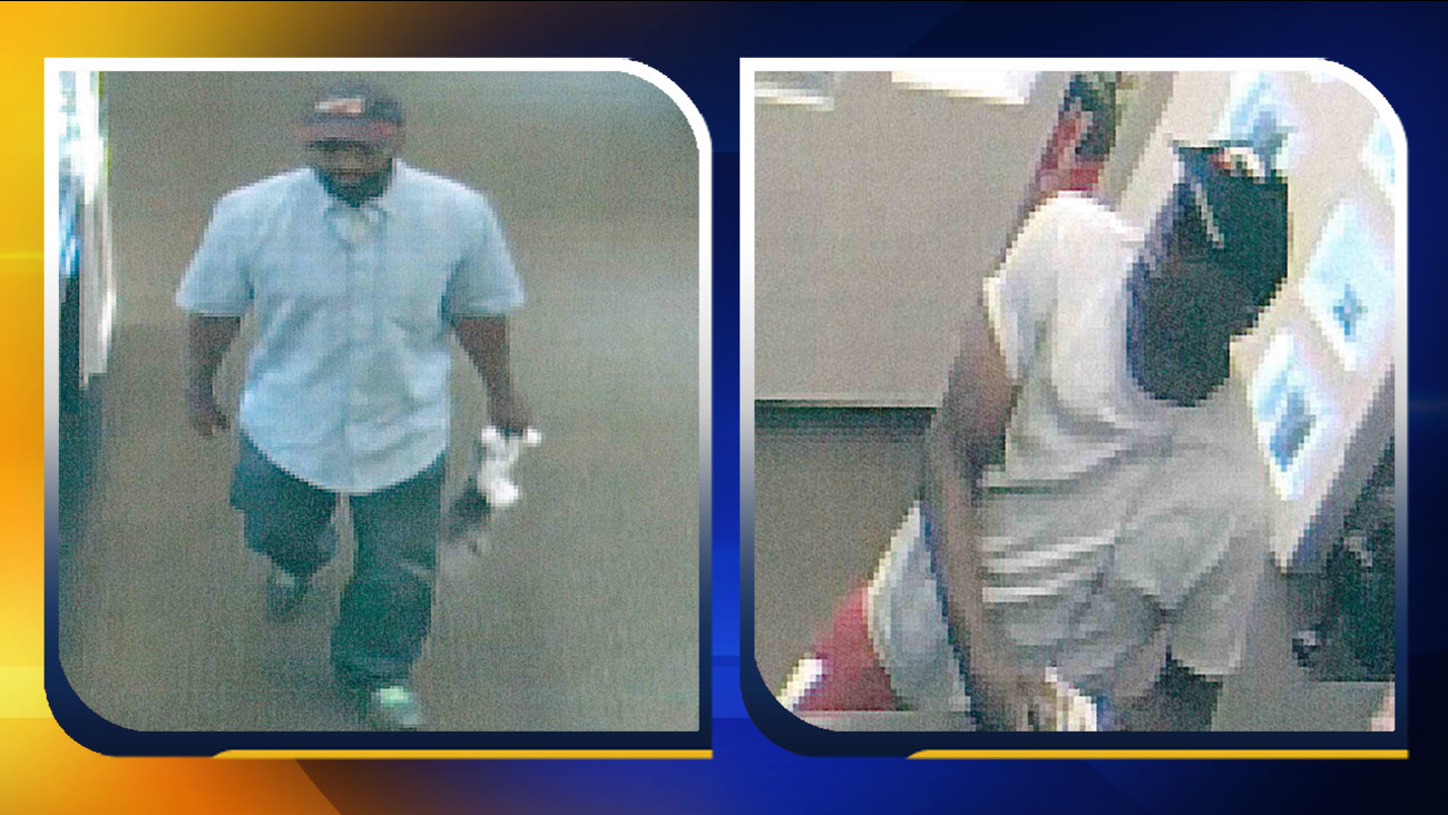 Surveillance photos of two robbery suspects at McNeill's Jewelry Store in Lumberton