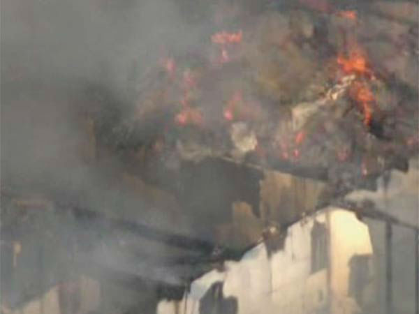 "<div class=""meta image-caption""><div class=""origin-logo origin-image none""><span>none</span></div><span class=""caption-text"">A two-alarm fire has destroyed a building in north Harris County.</span></div>"