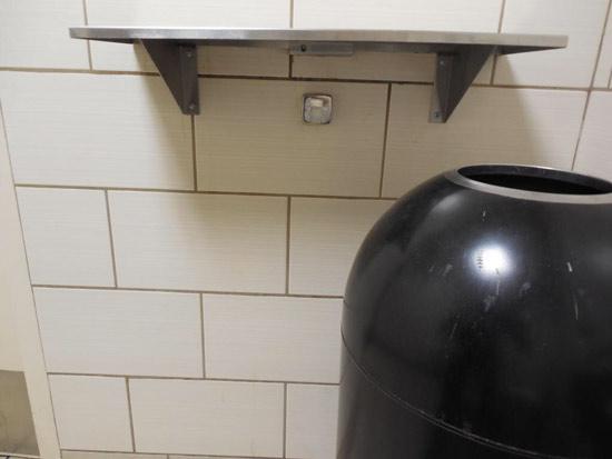 A hidden camera was found under this shelf in a Starbucks customer bathroom in Brea.