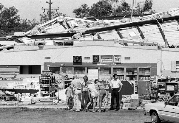 <div class='meta'><div class='origin-logo' data-origin='none'></div><span class='caption-text' data-credit='AP Photo'>Employees of the Spin-N-Mart food store taking inventory Saturday, August 20, 1983 to determine what Hurricane Alicia left behind after it took the roof off.</span></div>