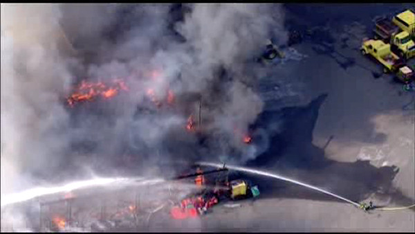 """<div class=""""meta image-caption""""><div class=""""origin-logo origin-image none""""><span>none</span></div><span class=""""caption-text"""">A large fire burned through a warehouse in Larchmont on Tuesday afternoon. (WABC Photo/ fire)</span></div>"""