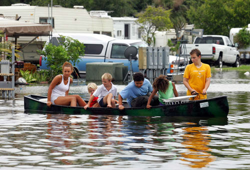 "<div class=""meta image-caption""><div class=""origin-logo origin-image none""><span>none</span></div><span class=""caption-text"">Jordan Hale, front, pulls kids in a canoe through a flooded mobile home park in Florida City, Fla., Friday, Aug. 26, 2005. (Photo/LUIS M. ALVAREZ)</span></div>"