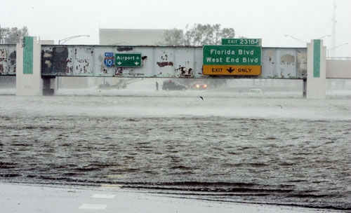 """<div class=""""meta image-caption""""><div class=""""origin-logo origin-image none""""><span>none</span></div><span class=""""caption-text"""">The Mound Underpass on Interstate-10 is flooded near downtown New Orleans on Monday, Aug. 29, 2005, as Hurricane Katrina dumped torrential rain. (Photo/BILL HABER)</span></div>"""