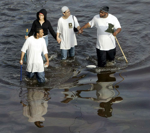 "<div class=""meta image-caption""><div class=""origin-logo origin-image none""><span>none</span></div><span class=""caption-text"">New Orleans residents walk through floodwaters that besiege the Crescent City on Tuesday, Aug. 30, 2005. (AP Photo/ BILL HABER)</span></div>"
