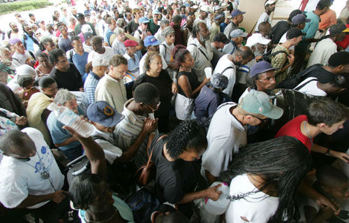 """<div class=""""meta image-caption""""><div class=""""origin-logo origin-image none""""><span>none</span></div><span class=""""caption-text"""">Hundreds of residents funnel into the Louisiana Superdome in New Orleans on Sunday, Aug. 28, 2005. (Photo/DAVE MARTIN)</span></div>"""