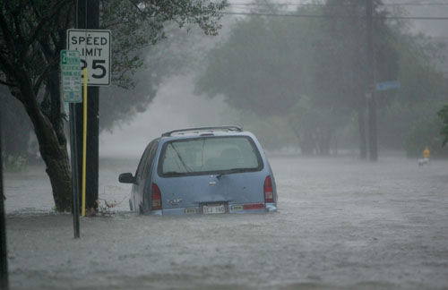 "<div class=""meta image-caption""><div class=""origin-logo origin-image none""><span>none</span></div><span class=""caption-text"">Floodwaters surround a car in uptown New Orleans early Monday, Aug. 29, 2005 as high winds and rain batter the LA coast as Hurricane Katrina makes landfall. (AP Photo/ DAVE MARTIN)</span></div>"